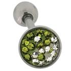 Zungenpiercing mit Kristallen mit einem grünen Yin Yang Muster